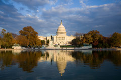 United States Capitol building. Scenic view of United States Capitol building reflecting on lake in foreground under cloudscape, Washington, D.C, U.S.A stock photography