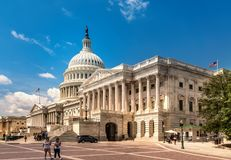 United States Capitol Building in Washington DC - East Facade of the famous US landmark with tourists. royalty free stock photo