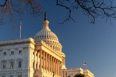 United States Capitol Building at winter time during sunset. Clear Blue Sky. stock photos