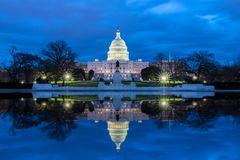 The United States Capitol with reflection at night, Washington DC stock photography