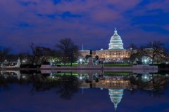The United States Capitol with reflection at night, Washington DC, USA royalty free stock photography