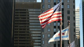 United States and Chicago Flags Waving on Chicago at Sunset. Flagstaff on the Golden Mile in Chicago city center stock video footage