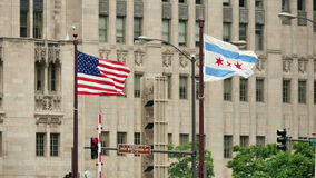 United States and Chicago Flags Waving on Michigan Bridge stock video footage
