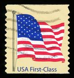 US Postage Stamp. UNITED STATES - CIRCA 2007: A postage stamp printed in the United States, features waving USA flag, first-class, circa 2007 stock images