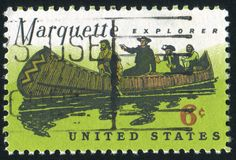 Father Marquette. UNITED STATES - CIRCA 1968: stamp printed by United States, shows Father Marquette, Louis Jolliet and natives, circa 1968 Royalty Free Stock Photo