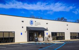 United States Citizenship and Immigration Services Center. Or building located in central Montgomery, Alabama.  Department of Homeland Security shield also Stock Photography
