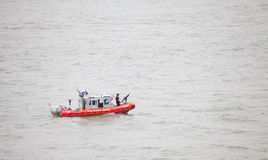The United States Coast Guard Boat on Hudson River. The United States Coast Guard (USCG) is a branch of the United States Armed Forces and one of seven uniformed royalty free stock image