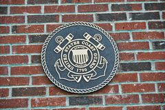 Coast Guard of the United States Challenge Coin on Brick. United States Coast Guard Challenge Coin Embedded in a brick slab Royalty Free Stock Photos