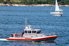 United States Coast Guard, Newport, RI. Member of the US Coast Guard patrol during the Parade of Sail in Newport, RI Royalty Free Stock Photography