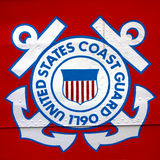 United States Coast Guard Shield Emblem on Ship. United States military armed forces branch Coast Guard shield emblem painted on the hull of a cutter ship as royalty free stock image