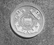 United States Coast Guard stone seal. At Purgatory Park Stock Photography