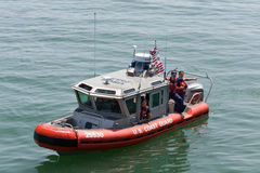 United States Coast Guard Vessel. SANTA CRUZ, CA/USA - June 30: Unidentified agents of the United States Coast Guard aboard a vessel patroling the Santa Cruz royalty free stock photo