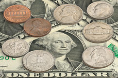 United states coins on one dollar bills Stock Photography