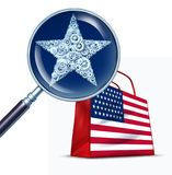 United States Commerce. Business concept as a magnifying glass studying a star close up made of cogs for the american flag as a 3D illustration royalty free stock image