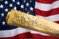 United States Constitution. With Flag in background Stock Photo