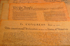 United States Constitution. Declaration of independence and the Preamble to the Constitution in the background Royalty Free Stock Photo