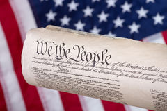 United States Constitution. With american flag in background Stock Photo