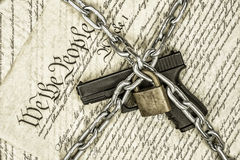 United States constitution and gun rights. A locked handgun symbolizing gun rights while framed against the United States constitution Royalty Free Stock Photos