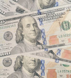 United States Currency Hundred Dollar Bills Background. A close up image with detail of multiple scattered United States $100 Bills Stock Image
