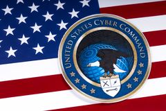 United States Cyber Command and the US Flag. LONDON, UK - MARCH 26TH 2018: The symbol of the United States Cyber Command portrayed with the US flag, on 26th royalty free stock images