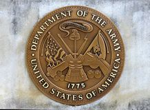 United States Department Of The Army Coin in a Concrete Slab. United States of America Department of the Army Challenge Coin Embedded in a concrete slab Royalty Free Stock Photo
