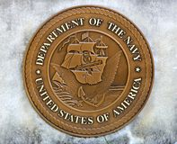 United States Department Of The Navy Coin in a Concrete Slab Royalty Free Stock Photos