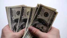 A man counts money in hands. United States Dollar in Mans Hand stock video