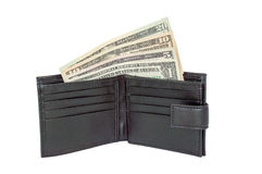 United States Dollars in a Wallet. United States One, Five, Ten and Twenty Dollar bills in a black wallet. Isolated on a white background Stock Photos