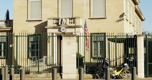 United States embassy flag half-mast to pay tribute. STRASBOURG, FRANCE - NOV 14, 2015: United States embassy flag half-mast to pay tribute to the victims of the stock video