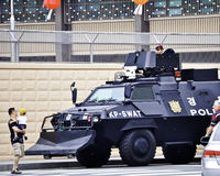 United States Embassy in Korea, police. Korean policeman in a gun turret on an armored a car in front of the US embassy office in Seoul 2010 during a hightened Royalty Free Stock Image
