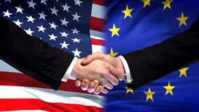 United States and EU handshake, international friendship, flag background. Stock photo royalty free stock photos