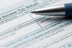 United States federal income tax return IRS 1040 document. With blue pen royalty free stock photo