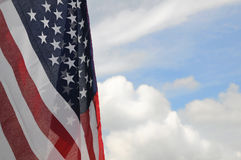 United States flag. With partly cloudy sky background Stock Photos