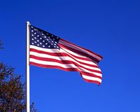 United States flag. United States of America flag against a blue sky, USA Stock Photo