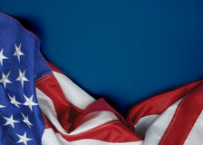 United States Flag. A United States of America flag draped as a border with a blue background and copy space stock photography