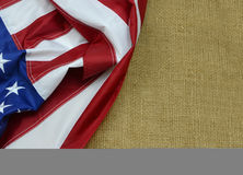 United States Flag. A United States of America flag draped as a border with a burlap background and copy space stock photo