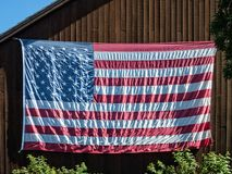 United States Flag on barn Stock Photo
