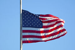 United States Flag Being Raised Stock Photo