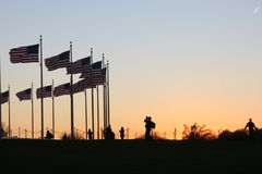 United states flag with camera. Boy shot a photo with his camera to flag Royalty Free Stock Photography