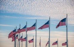 United States Flag Circling the Washington Monument at Sunset Stock Images