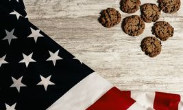 United states flag and cookies, all on wooden table royalty free stock image