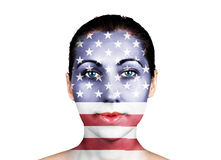 United States flag on a  face. United States flag on a woman face Royalty Free Stock Image