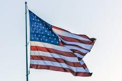United States Flag. The United States Flag flies high above Foss Harbor Marina in Tacoma, Washington stock photography
