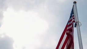 United States flag flying from a flagpole stock video