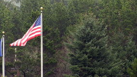 United States Flag Flying In Gentle Breeze From Flagpole In Pouring Rain stock video