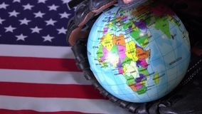 United States Flag and Globe. The United State flag and a baseball inside a glove. The US is one of the strongest countries in the world regarding baseball sport stock video
