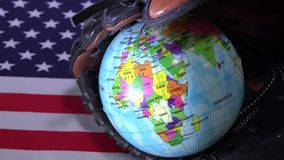United States Flag and Globe. The United State flag and a baseball inside a glove. The US is one of the strongest countries in the world regarding baseball sport stock video footage