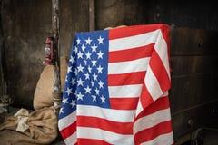 United states flag on mining gold rush equipment royalty free stock photo