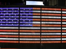 The united states flag in neon on a stadium. The united states flag in neon at night Stock Image