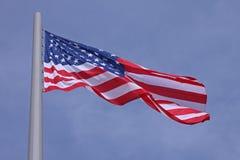 United States flag. Over blue sky Stock Photos